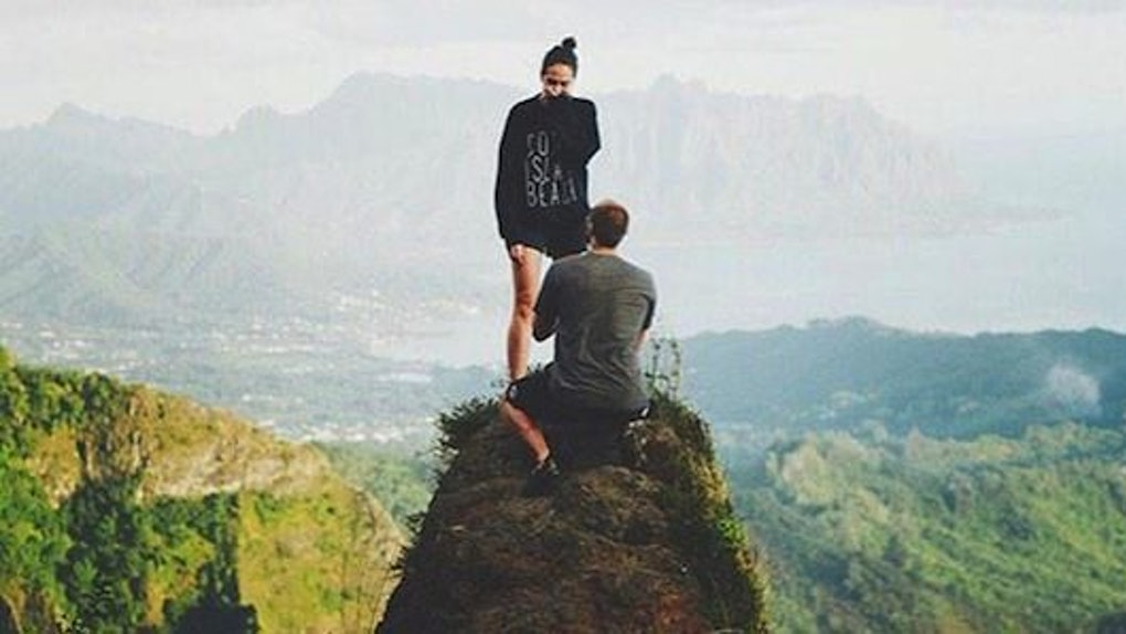 lover proposes at mountain